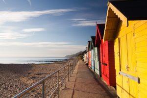 colourful beach huts and beach and sea