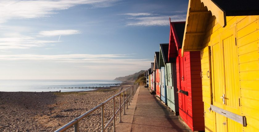colourful beach huts and beach and sea