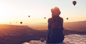 watching hot air balloons from a rock
