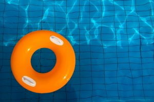 swimming pool with rubber ring in