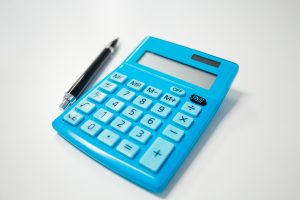 pen and blue calculator